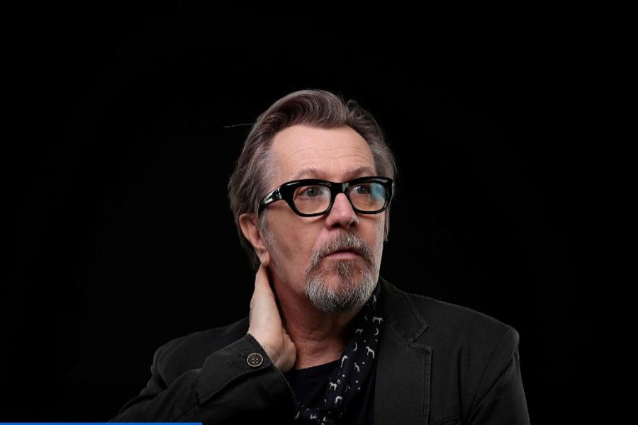 """British actor Gary Oldman, who stars in the film """"Darkest Hour"""" about Winston Churchill, poses for a portrait in Beverly Hills, California US November 09, 2017. REUTERS/Lucy Nicholson/File Photo"""