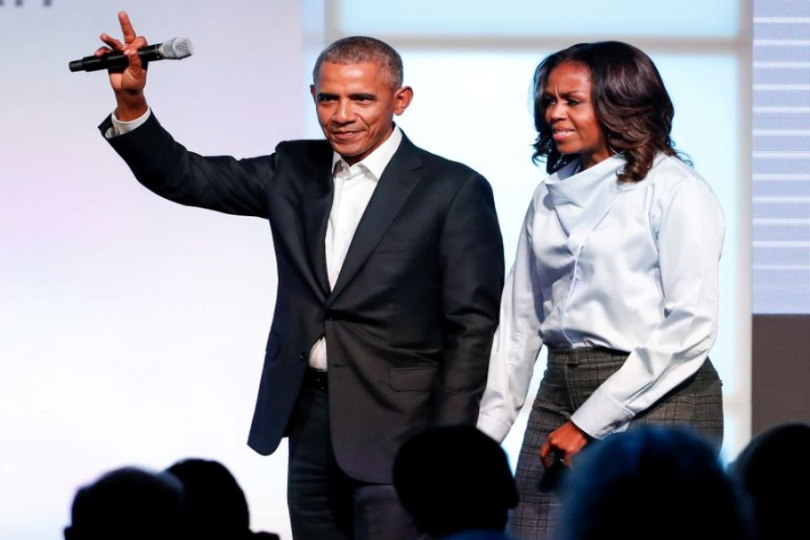 FILE PHOTO: Former US President Barack Obama and former first lady Michelle Obama greet guests during the first day of the Obama Foundation Summit in Chicago, Illinois, US, October 31, 2017. REUTERS/Kamil Krzaczynski/File Photo