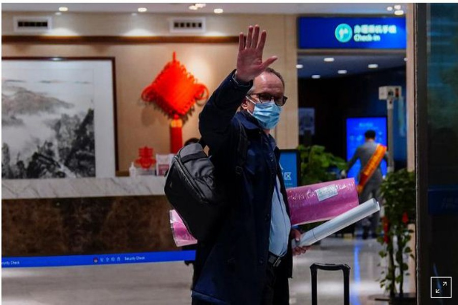 Peter Ben Embarek, a member of the World Health Organization (WHO) team tasked with investigating the origins of the coronavirus disease (COVID-19), waves as he arrives at the airport to leave Wuhan, Hubei province, China February 10, 2021. REUTERS/Aly Song