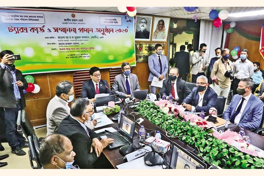 State Minister for Public Administration Farhad Hossain speaking at a ceremony organised to honour the taxpayers with tax cards at the conference room of the National Board of Revenue (NBR) in the city on Thursday — FE Photo