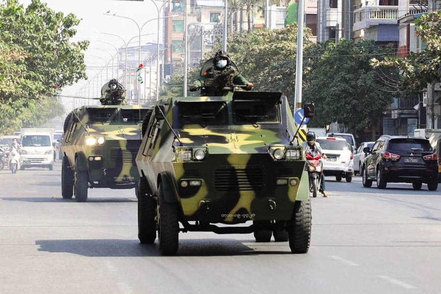 Myanmar army armoured vehicles drive in a street after the military seized power in a coup in Mandalay, Myanmar, February 3. —Reuters