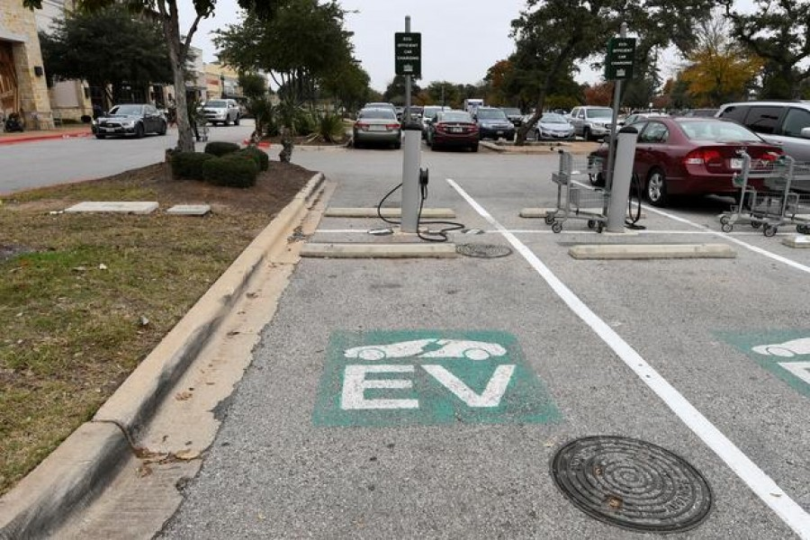 An electric vehicle (EV) fast charging station is seen in the parking lot of a Whole Foods Market in Austin, Texas, US, December 14, 2016. REUTERS/Mohammad Khursheed