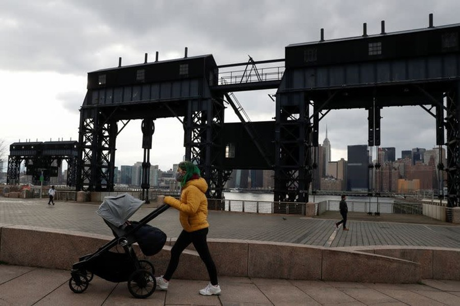 A woman wearing a protective face mask pushes a baby stroller, amid the spread of the coronavirus disease (Covid-19), at Gentry Plaza State Park in the Queens borough of New York, US on, March 1, 2021 — Reuters/Files
