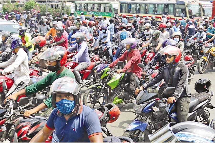 Motorcyclists staging protest recently in Dhaka against a move to halt ride-sharing services amid a sharp rise in coronavirus cases in the country —FE file photo