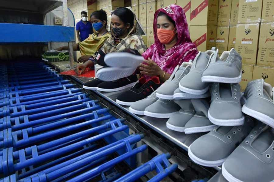Workers making shoes at the factory of Panda Shoes Industries Ltd. in Gazipur recently -Xinhua photo