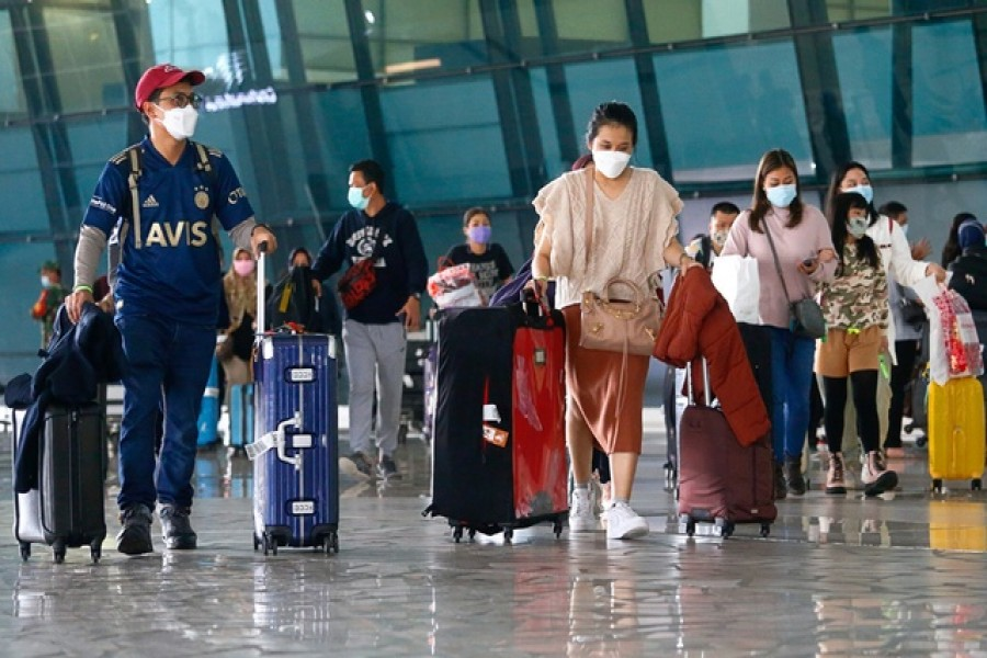 Visitors walk after they arrived at the Soekarno-Hatta Airport following Indonesia's government decision to ban foreign tourists from entry to prevent the spread of coronavirus disease (Covid-19), in Tangerang, on the outskirts of Jakarta, Indonesia, Jan 1, 2021 — Reuters/Files