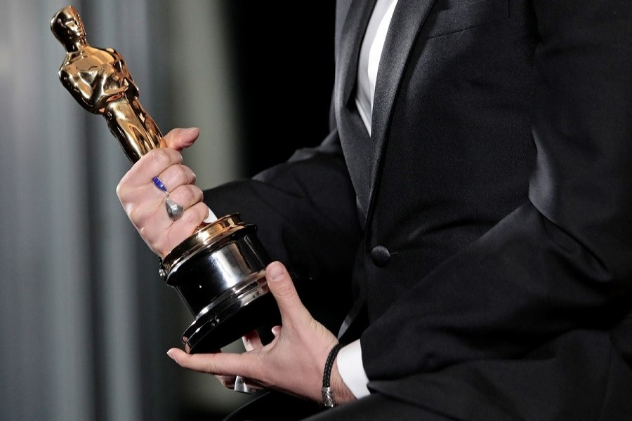 """Florian Zeller holds his Oscars statuette after winning the Best Adapted Screenplay for the """"The Father"""" at a screening of the Oscars in Paris, France, April 26, 2021 — Lewis Joly/Pool via Reuters"""