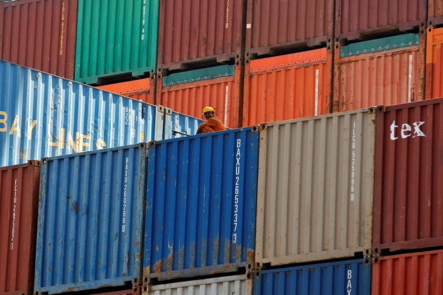 A worker sits on a ship carrying containers at Mundra Port in the western Indian state of Gujarat, April 1, 2014 — Reuters/Files