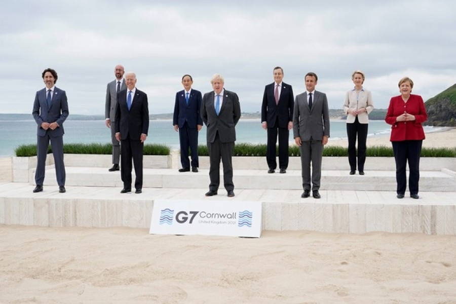 Canadian Prime Minister Justin Trudeau, European Council President Charles Michel, US President Joe Biden, Japan's Prime Minister Yoshihide Suga, British Prime Minister Boris Johnson, Italy's Prime Minister Mario Draghi, French President Emmanuel Macron, European Commission President Ursula von der Leyen and German Chancellor Angela Merkel pose for a group photo at the G7 summit, in Carbis Bay, Britain, June 11, 2021 — Reuters