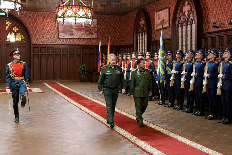 Russia's Defence Minister Sergei Shoigu and Myanmar's Commander in-Chief Senior General Min Aung Hlaing walking past the honour guard prior to their talks in Moscow on Tuesday -Reuters photo