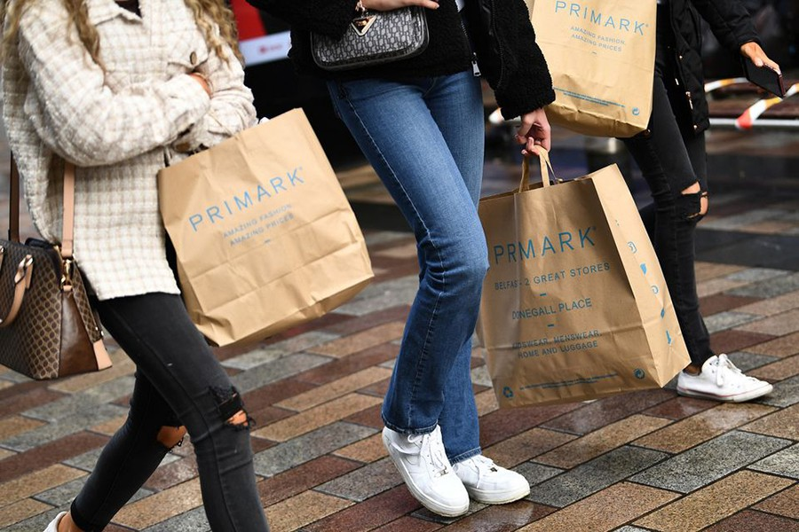 People carry Primark shopping bags after retail restrictions due to coronavirus disease (COVID-19) eased, in Belfast, Northern Ireland, May 4, 2021. REUTERS/Clodagh Kilcoyne
