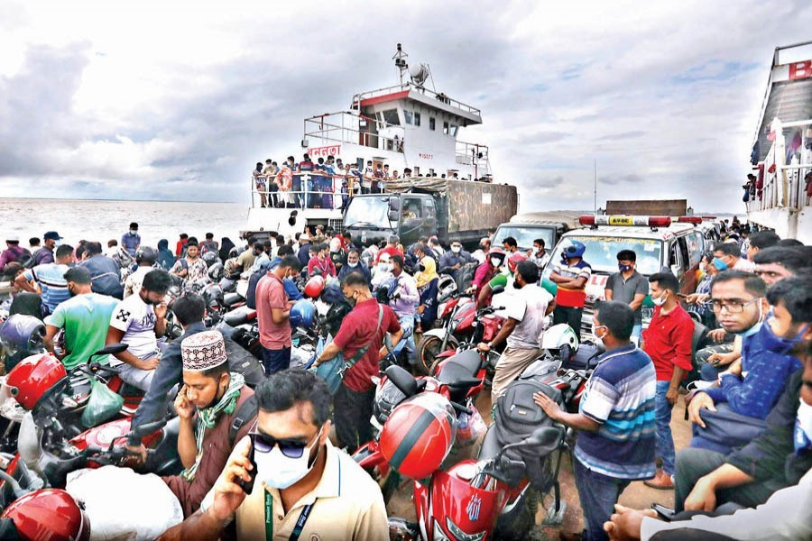 Despite strict lockdown, Eid holidaymakers continue to return to Dhaka braving all odds. The photo of a packed ferry was taken at Doulatdia Ferry Terminal in Rajbari on Saturday — FE photo