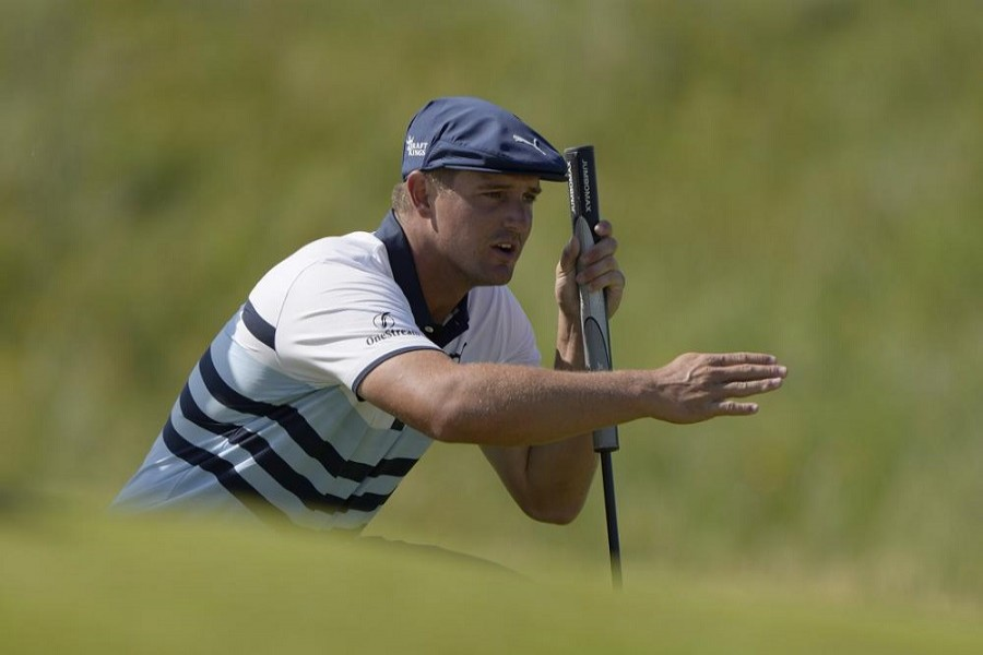 In this July 17, 2021, file photo, United States' Bryson DeChambeau gestures as he lines up his putt on the 2nd green during the third round of the British Open Golf Championship at Royal St George's golf course Sandwich, England – AP Photo/Alastair Grant