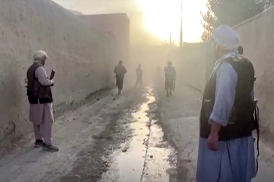 Smoke hovers at the site of an explosion as Afghan forces clash with Taliban fighters near Kunduz, Afghanistan on July 10, 2021, in this picture obtained by Reuters from a video