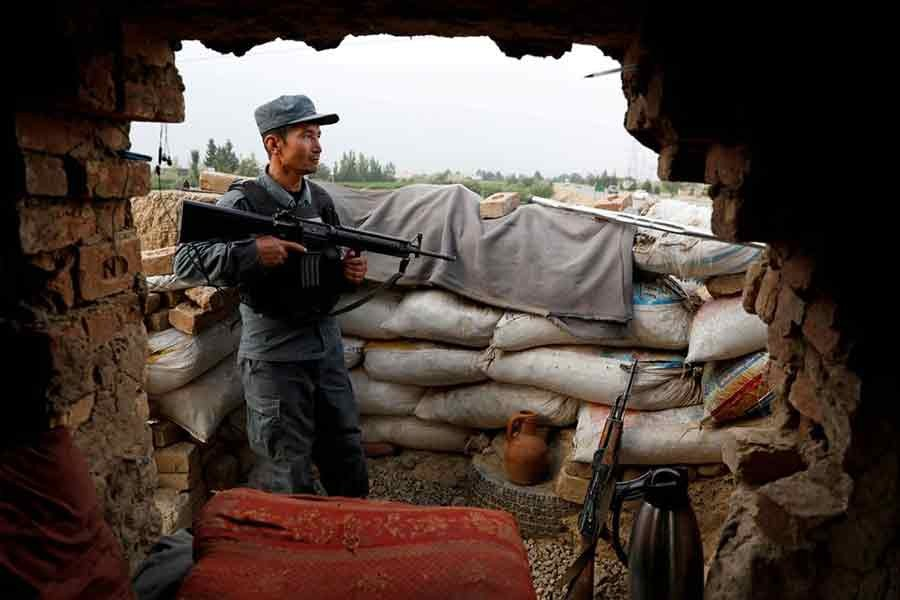 An Afghan policeman keeping watch at the check post on the outskirts of Kabul on July 13 this year -Reuters file photo