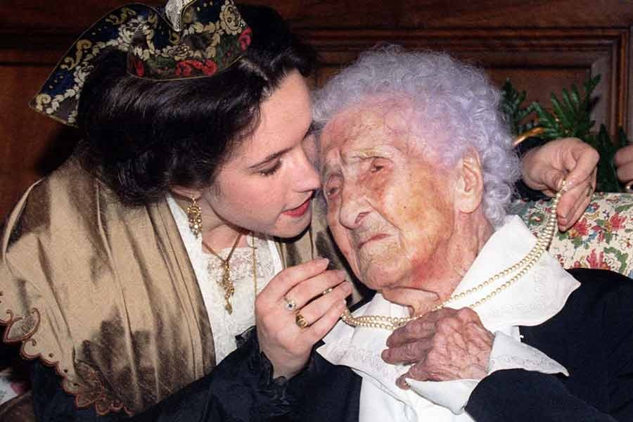 Jeanne Calment celebrates her 121st birthday with a kiss from Catherine Sautecoeur in Arles, France, on February 21 1996.