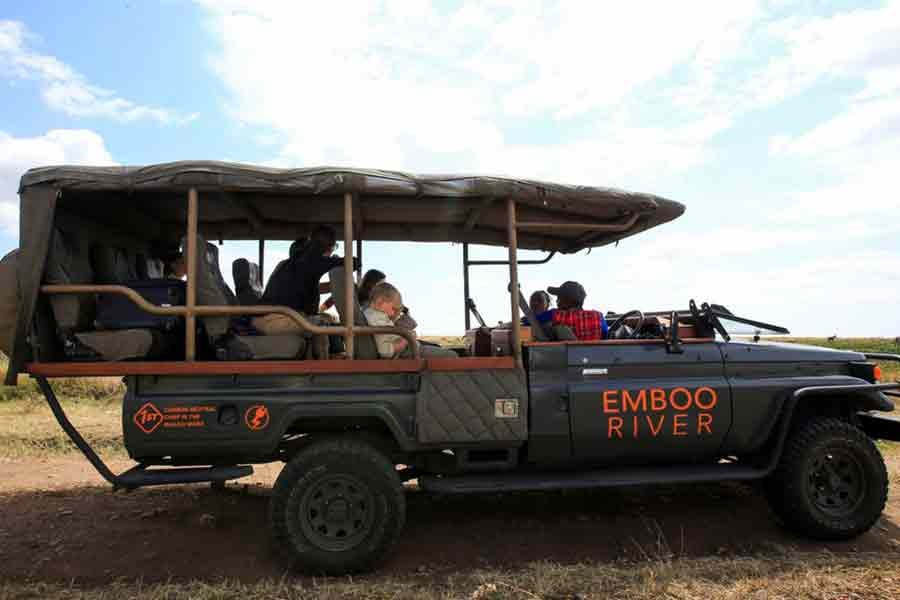 Gladys Kisemei, a tour guide at the Emboo River Camp, driving tourists from the Ol Kiombo airstrip using an electric-powered safari vehicle at the Maasai Mara National Reserve in Narok County of Kenya on July 16 this year -Reuters file photo