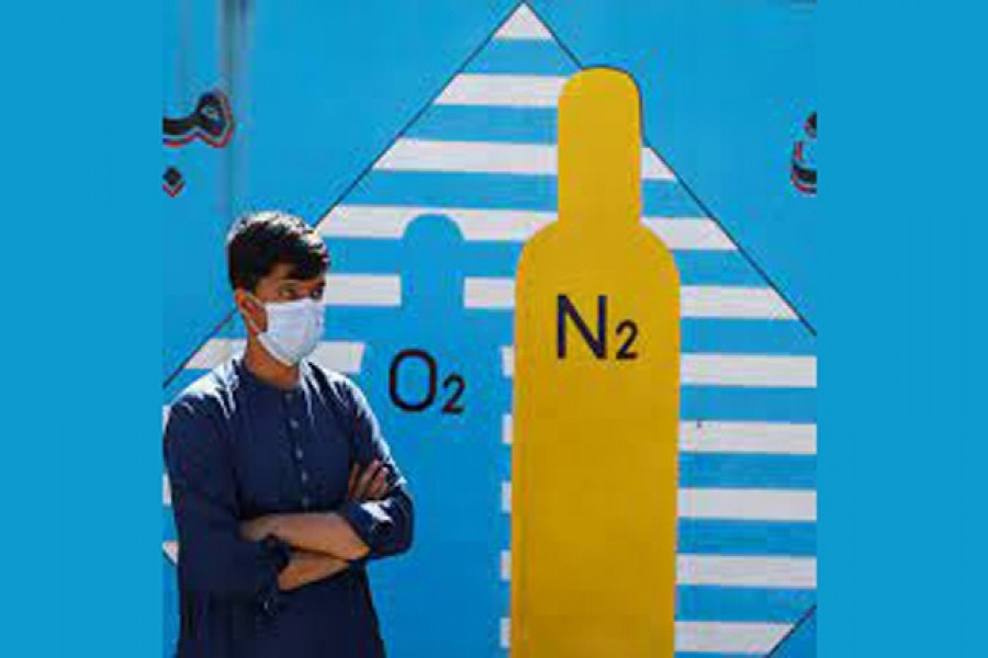 A man waits outside a factory to get his oxygen cylinder refilled, amidst the spread of the coronavirus disease (COVID-19) in Kabul, Afghanistan June 15, 2021. REUTERS