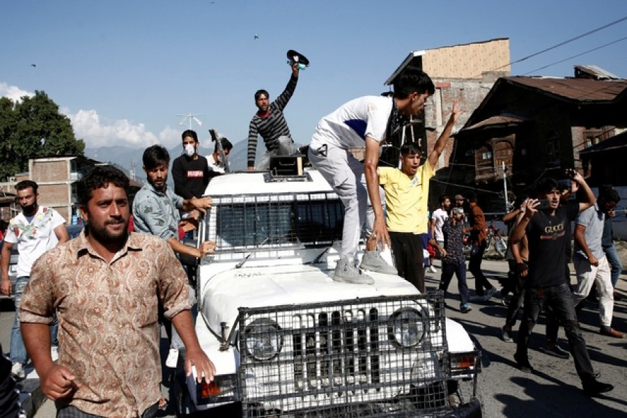 Kashmiri Shi'ite Muslim mourners shout slogans atop a police vehicle during a Muharram procession ahead of Ashura in Srinagar Aug 17, 2021. REUTERS/Danish Ismail/File