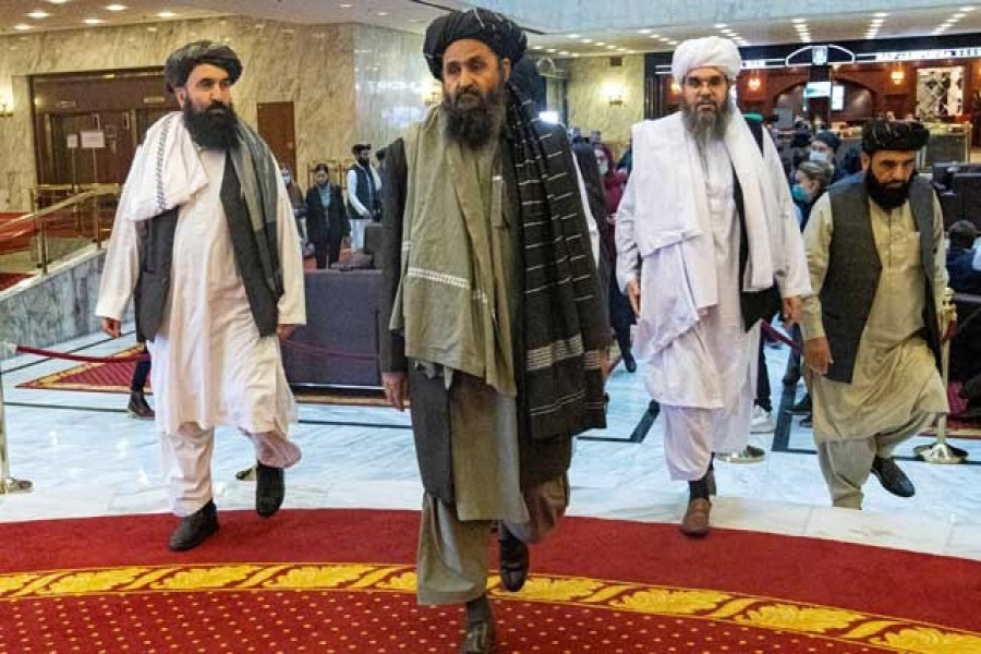 Mullah Abdul Ghani Baradar, the Taliban's deputy leader and negotiator, and other delegation members attend the Afghan peace conference in Moscow, Russia, March 18, 2021 — Alexander Zemlianichenko/Pool via Reuters