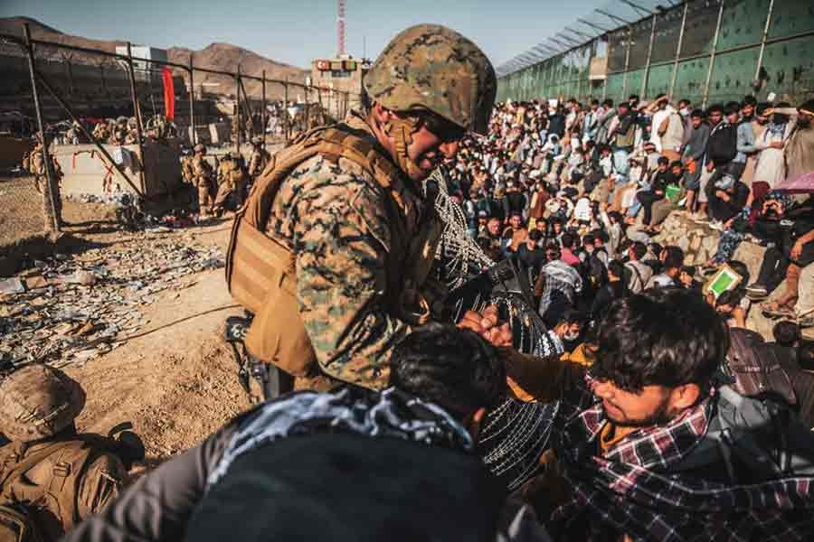 A US Marine assisting at an Evacuation Control Check Point (ECC) during an evacuation at Hamid Karzai International Airport in Kabul of Afghanistan on August 26 -Reuters file photo