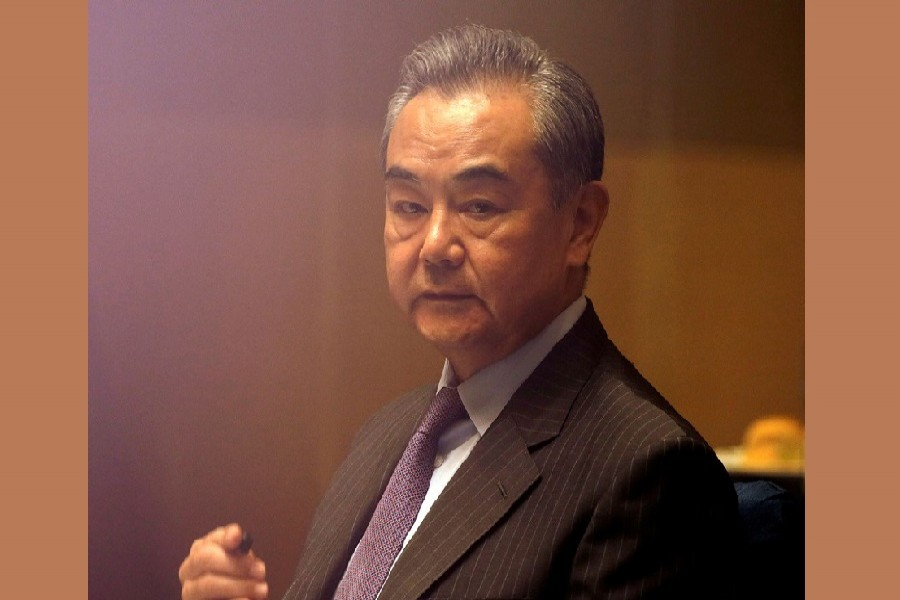 China's Foreign Minister Wang Yi listens during a meeting in Manila, Philippines January 16, 2021 — Francis Malasig/Pool via Reuters