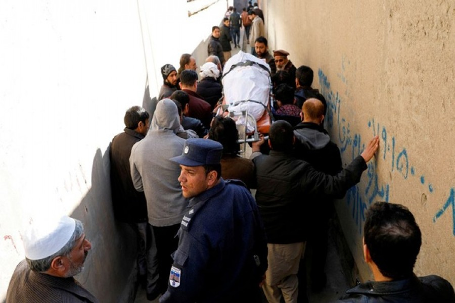 Relatives carry the body of a female judge shot dead by unknown gunmen in Kabul, Afghanistan January 17, 2021 — Reuters/Files