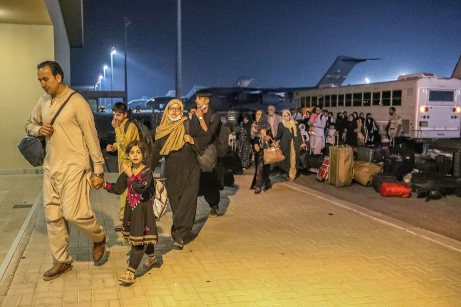 Evacuees from Afghanistan arrive at Al-Udeid airbase in Doha, Qatar in this recent undated handout — Government Communications Office of the State of Qatar Handout via REUTERS