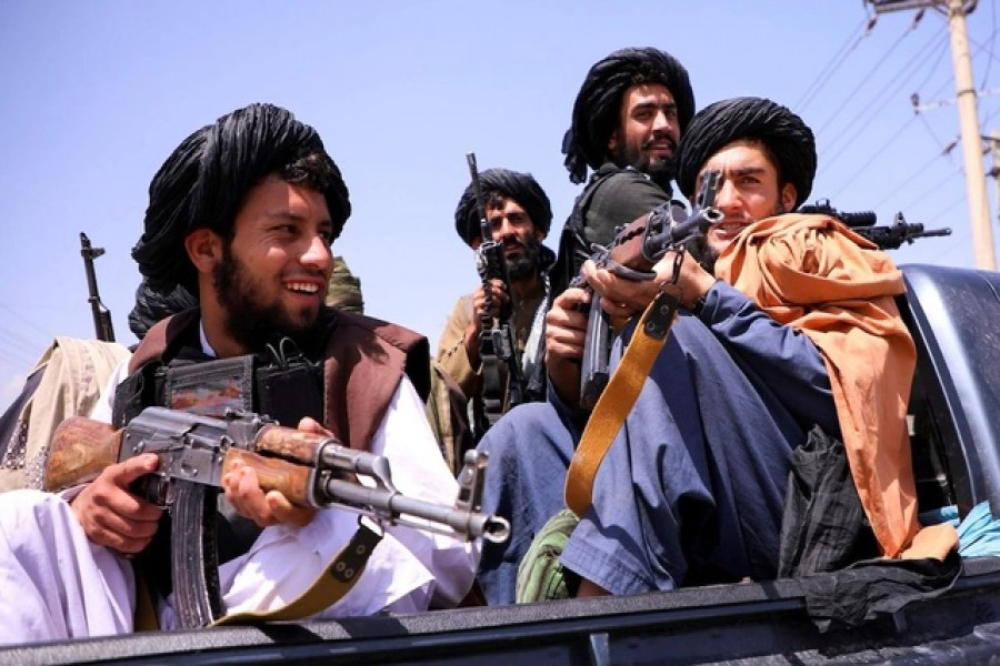 Taliban forces patrol in front of Hamid Karzai International Airport in Kabul, Afghanistan, Sept 2, 2021. REUTERS