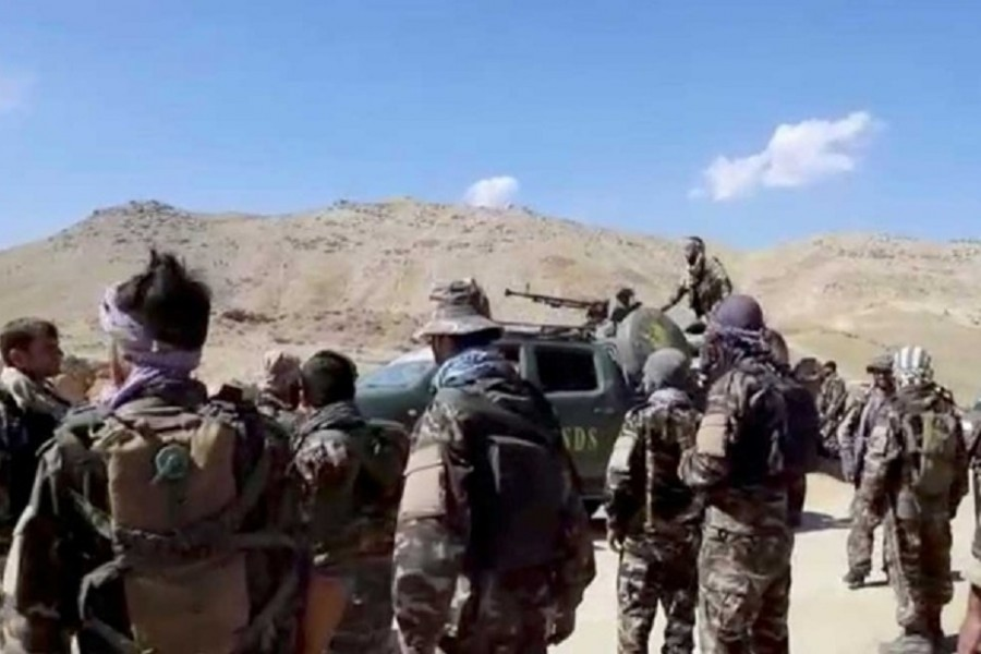 A truck with National Resistance Front markings is seen on a mountain top near Panjshir Valley, Afghanistan in this still image obtained from an undated video handout. Handout via REUTERS