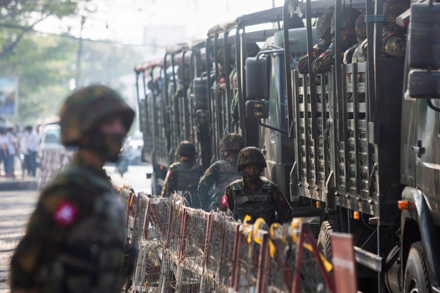 Soldiers stand next to military vehicles as people gather to protest against the military coup, in Yangon, Myanmar on February 15, 2021 — Reuters photo