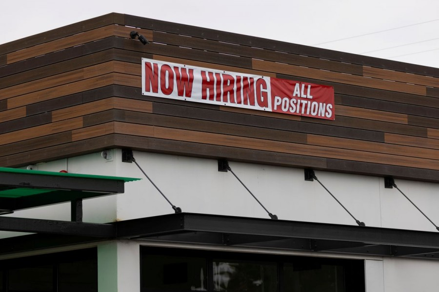 A restaurant advertising jobs looks to attract workers in Oceanside, California, US on May 10, 2021 — Reuters/Files