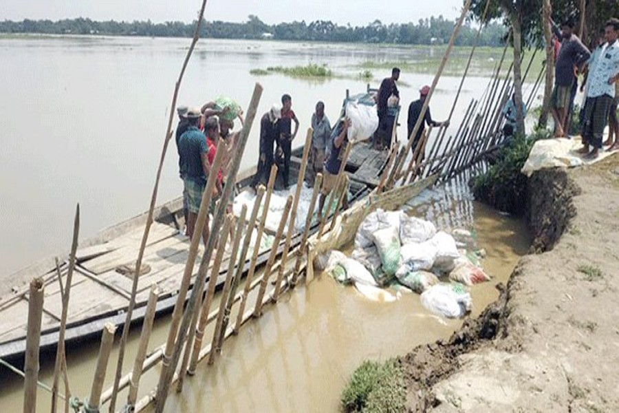 Villagers try to protect rural road from erosion