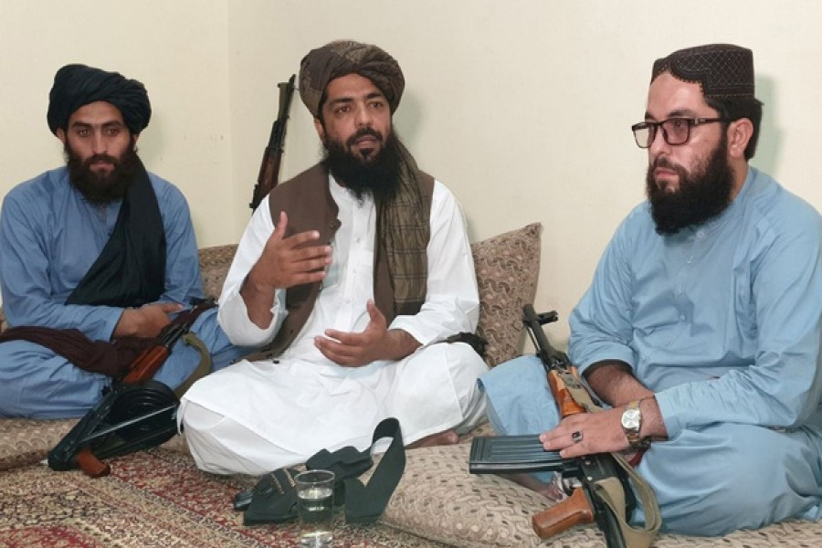 Waheedullah Hashimi (C), a senior Taliban commander, gestures as he speaks with Reuters during an interview at an undisclosed location near Afghanistan-Pakistan border August 17, 2021 — Reuters/Stringer
