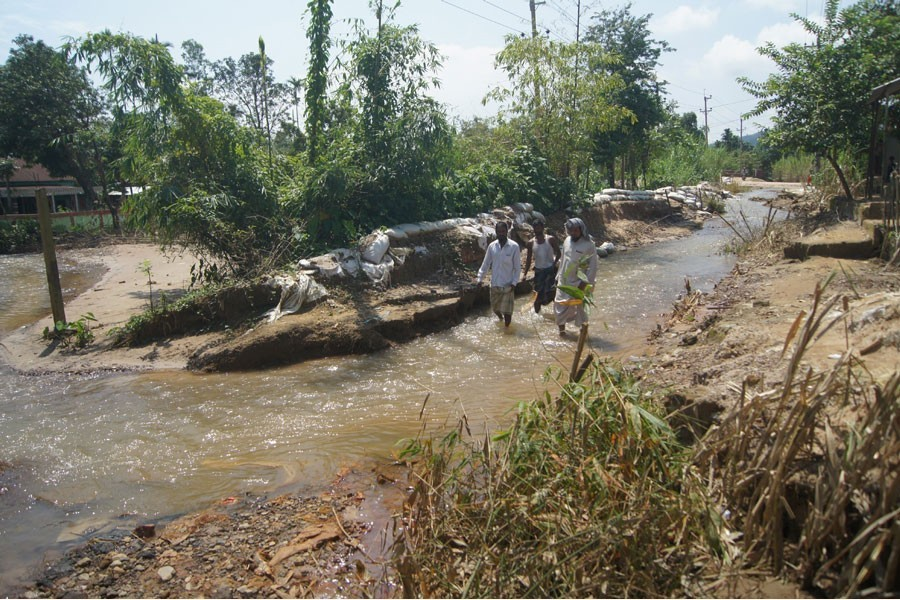 Water passing through ditches developed on Tahirpur-Tekerghat road by rolling waters from Meghalaya hills — FE Photo
