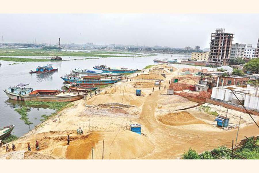 Sand traders filling a part of Turag river in Dhaka