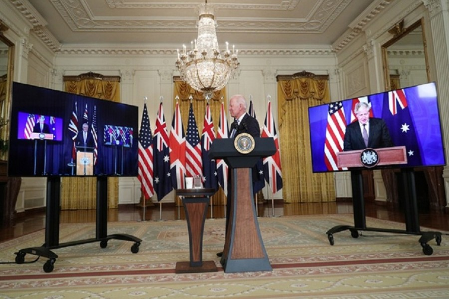 US President Joe Biden delivers remarks on a National Security Initiative virtually with Australian Prime Minister Scott Morrison and British Prime Minister Boris Johnson, inside the East Room at the White House in Washington, US, September 15, 2021. REUTERS/Tom Brenner