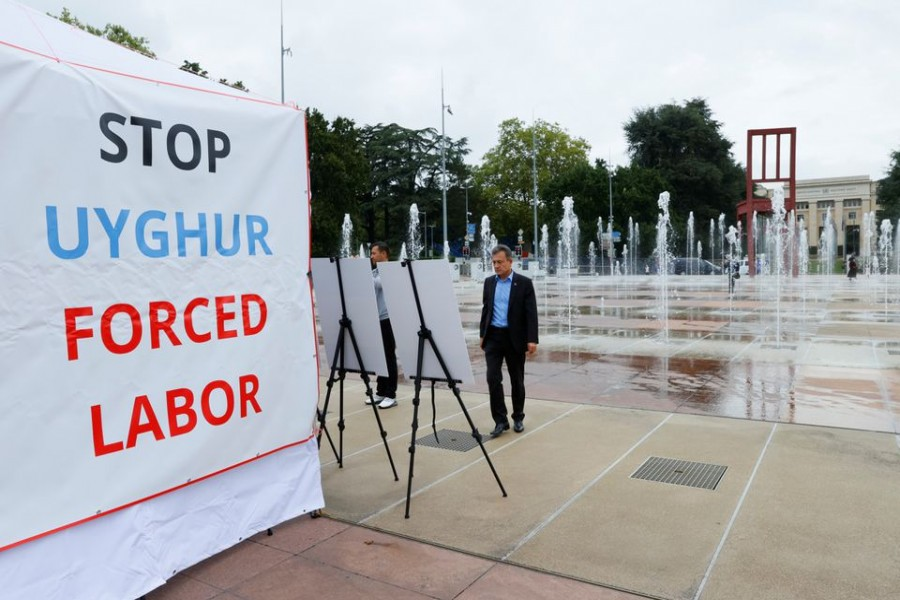 Dolkun Isa, President of the World Uyghur Congress, poses at a United States-backed Uyghur photo exhibit of dozens of people who are missing or alleged to be held in Chinese-run camps in Xinjiang, China in front of the United Nations in Geneva, Switzerland, September 16, 2021 — Reuters