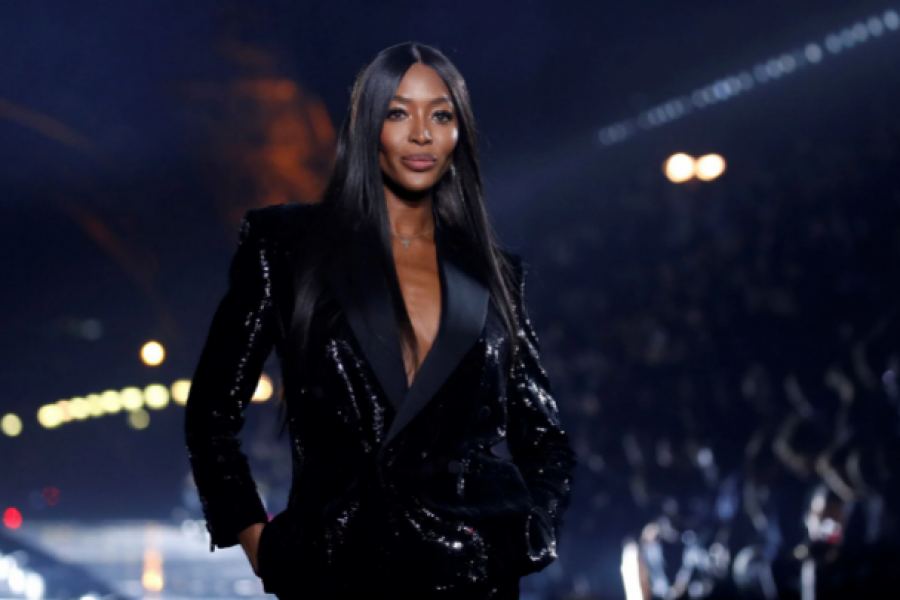 Naomi Campbell presents a creation by designer Anthony Vaccarello as part of his Spring/Summer 2020 women's ready-to-wear collection show for fashion house Saint Laurent during Paris Fashion Week in Paris, France, September 24, 2019. REUTERS/Gonzalo Fuentes/File Photo