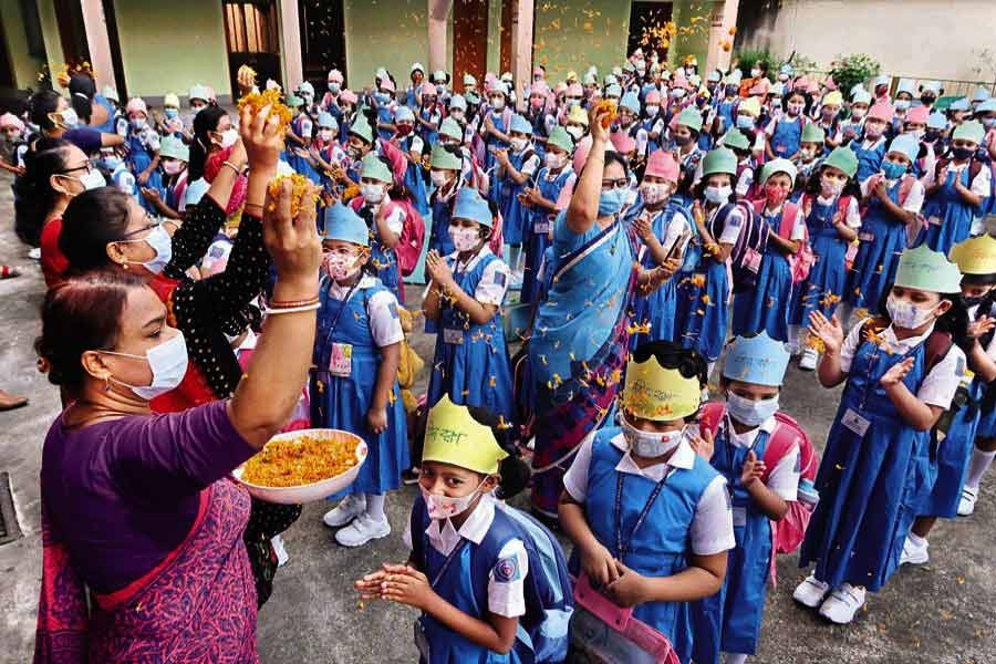 Teachers receiving students by showering them with flower petals at St. Francis Xavier's Girls' School and College in Luxmibazar of Old Dhaka on September 12 this year, the first day of the reopening of educational institutions after long Covid-induced closure — FE file photo