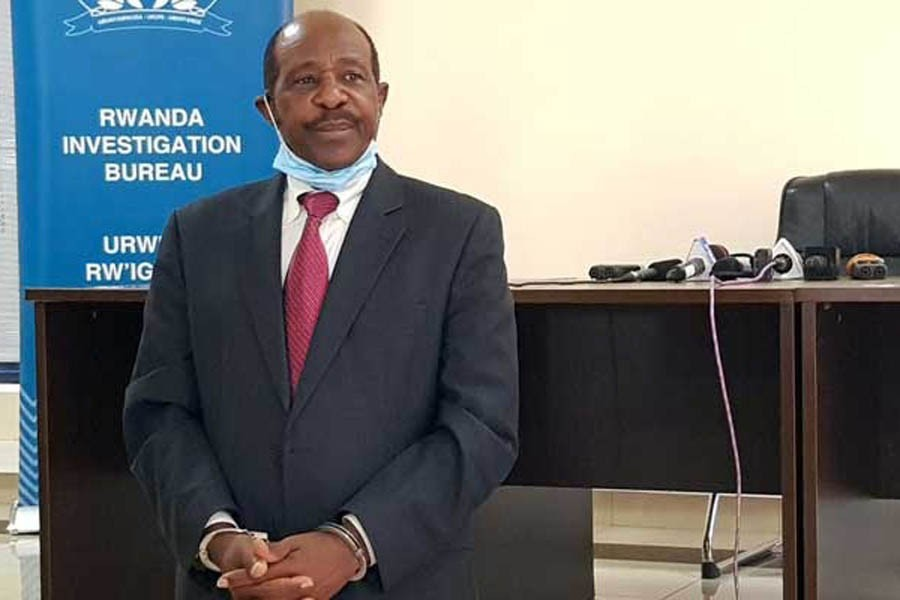 Paul Rusesabagina, the man who was hailed a hero in a Hollywood movie about the country's 1994 genocide is detained and paraded in front of media in handcuffs at the headquarters of Rwanda Investigation Bureau in Kigali, Rwanda August 31, 2020. REUTERS/Clement Uwiringiyimana