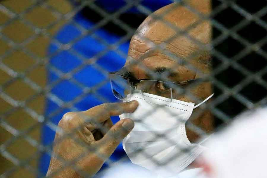 Sudan's ousted President Omar al-Bashir is seen inside the defendant's cage during his and some of his former allies trial over the 1989 military coup that brought the autocrat to power in 1989, at a courthouse in Khartoum, Sudan on September 15 last year –Reuters file photo