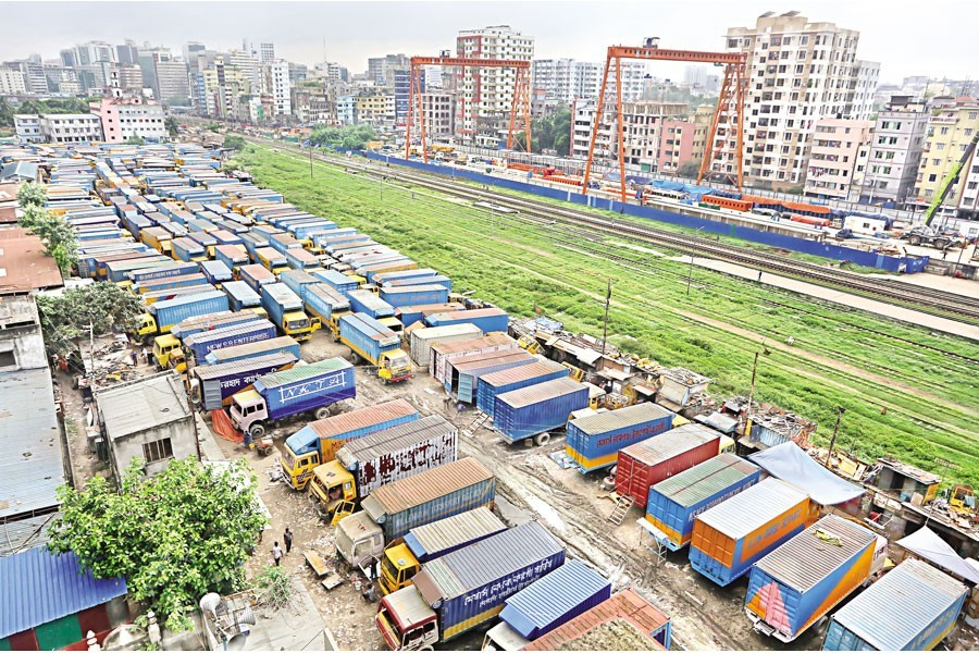 Covered vans, used to transport goods across the country, lie idle at Tejgaon Truck Stand in the city as owners of trucks and covered vans and their workers enforced a strike from 6:00am on Tuesday — FE photo by KAZ Sumon