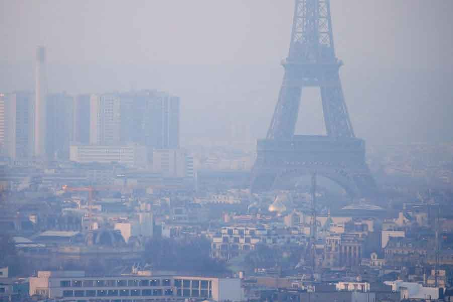 The Eiffel Tower is surrounded by a small-particle haze which hangs above the skyline in France on December 9 in 2016 –Reuters file photo