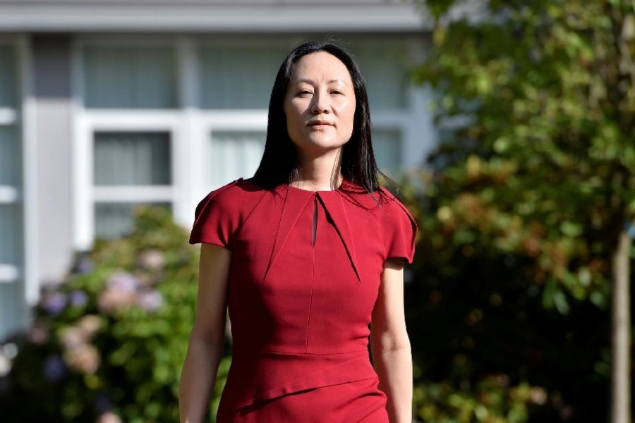 Huawei Technologies Chief Financial Officer Meng Wanzhou leaves her home to attend a court hearing in Vancouver, Canada, August 10, 2021. REUTERS/Jennifer Gauthier