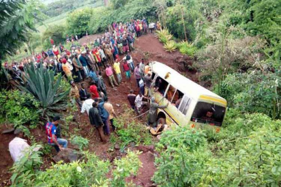 Residents gather at the scene of an accident that killed schoolchildren, teachers and a minibus driver at the Rhota village along the Arusha-Karatu highway in Tanzania's northern tourist region of Arusha on Saturday. – Reuters photo