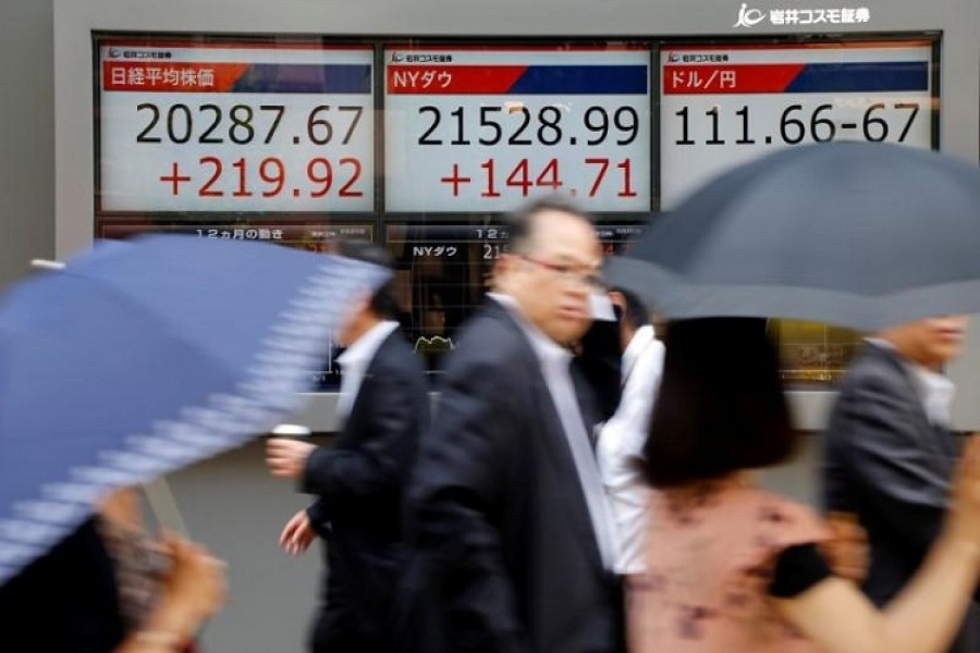 Asia stocks buoyant, dollar steadies after solid US job gains