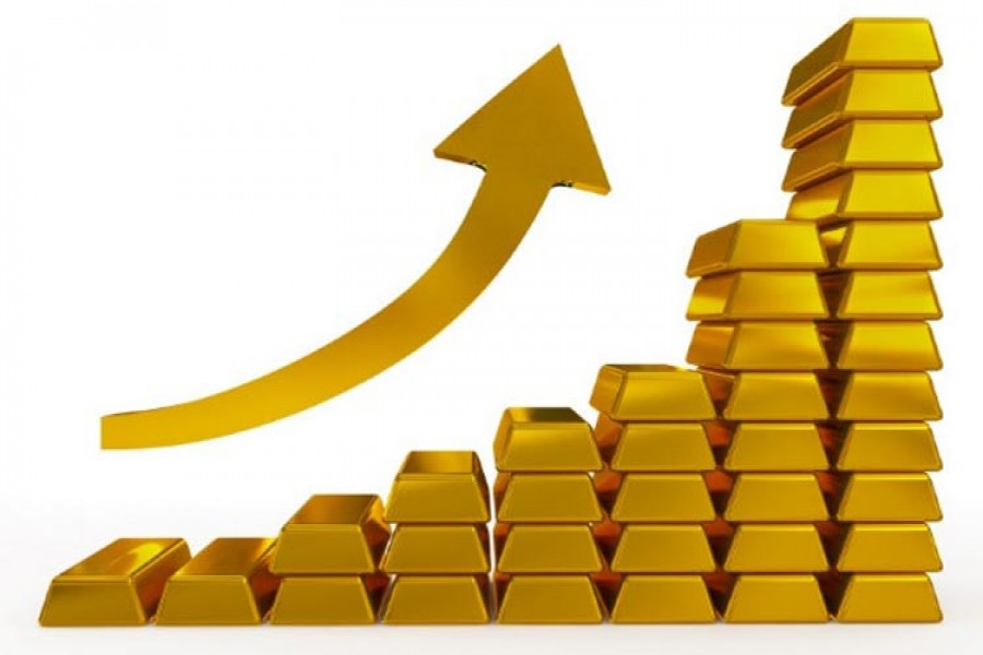 Gold prices up on softer dollar