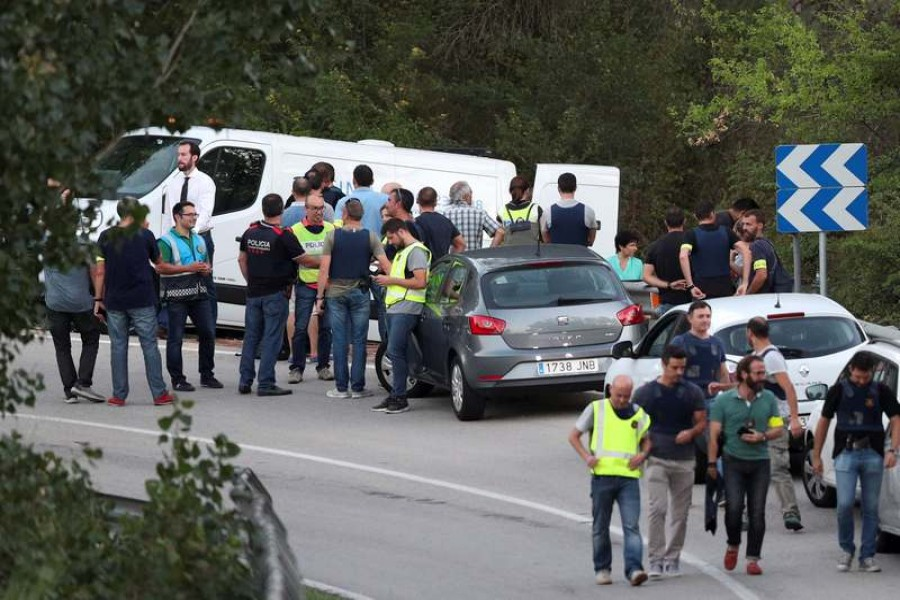 A funeral van is parked in the place where Younes Abouyaaqoub, the man suspected of driving the van that killed 13 people in Barcelona last week, was killed by police in Subirats, Spain on Monday.