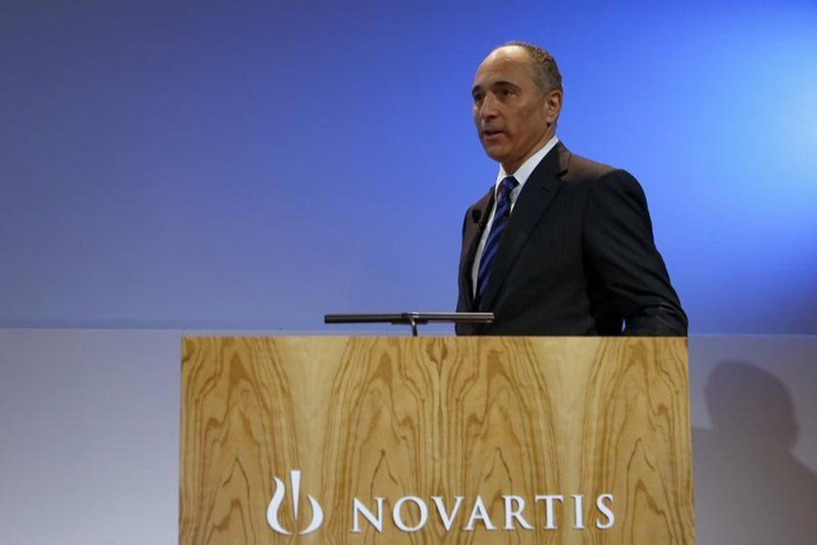 CEO Joseph Jimenez of Swiss drugmaker Novartis arrives to address the company's annual news conference in Basel on January 29, 2014. - File photo